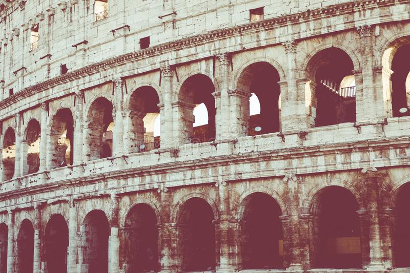 Rome, Italy.One of the most popular travel place in world - Roman Coliseum under evening sun light and sunrise sky. royalty free stock images