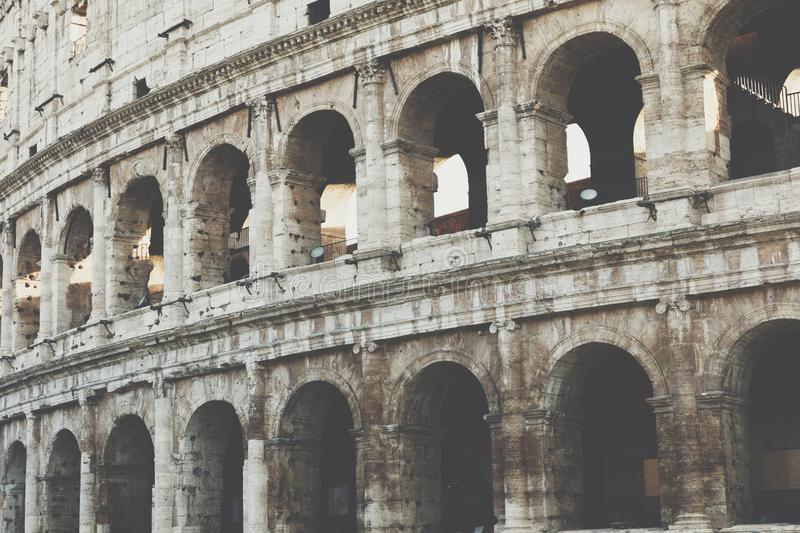 Rome, Italy.One of the most popular travel place in world - Roman Coliseum under evening sun light and sunrise sky. stock photos