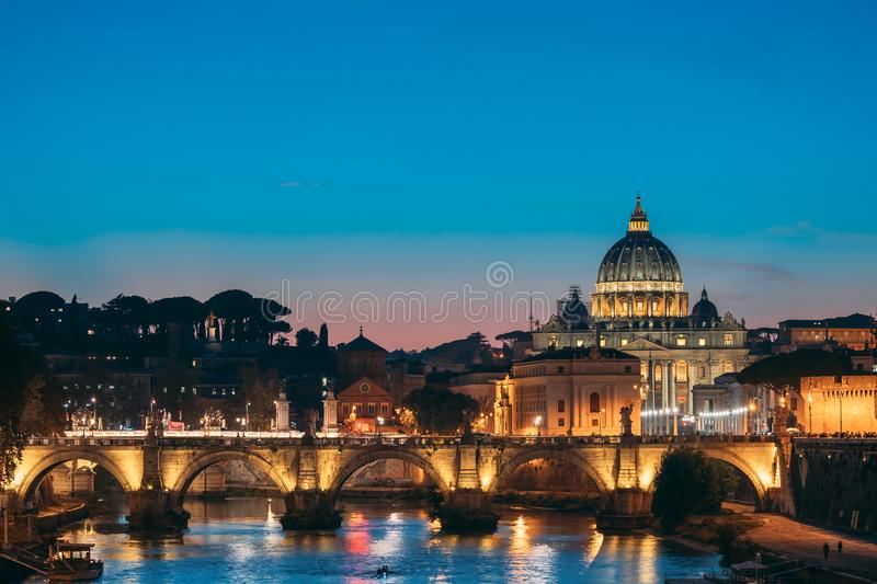 Rome, Italy. Papal Basilica Of St. Peter In The Vatican And Aelian Bridge In Evening Night Illuminations. Rome, Italy - October 19, 2018: Papal Basilica Of St stock photo