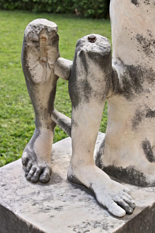 Marble legs of a Roman sculpture royalty free stock images
