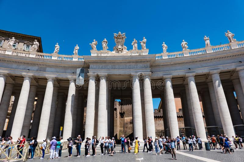 ROME, Italy- 2019: Saint Peter Square Piazza San Pietro Vatican with Tourists waiting for entering the Basilica royalty free stock photography