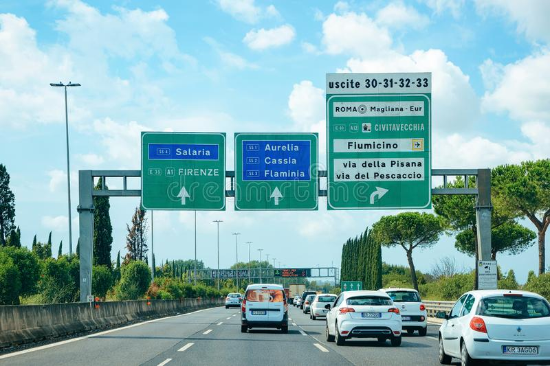 Cars and traffic signs to Firenze and Roma in the road in Italy. Rome, Italy - September 7, 2017: Cars and traffic signs to Firenze and Roma in the road in Italy stock photo