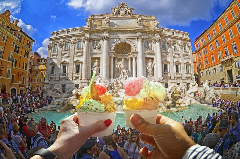Couple with Italian sweet ice - cream cone with different flavors held in hand royalty free stock photography