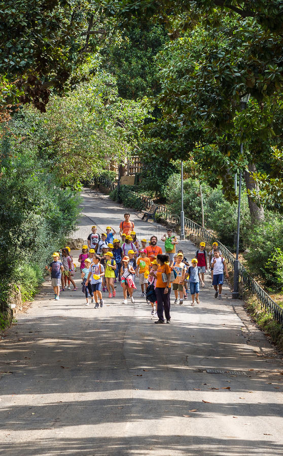 ROME, ITALY - September 5 2016:Group of children goes on a tour of Roma zoo. Vacation, a day off, explore, stock photography