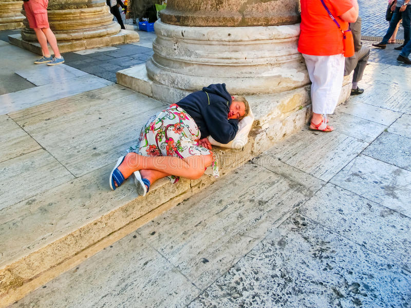 Rome, Italy - September 10, 2015: A homeless woman sleeping lying at Panteon in the center of Rome, Italy stock photos