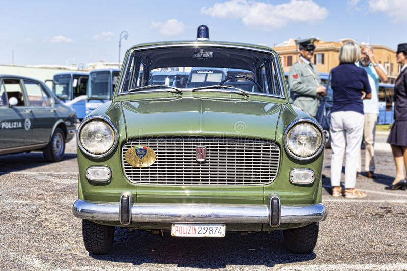 A beautiful green vintage FIAT 1100 exhibited for the 50th year of foundation of the National Association of Italian State Police. Rome,Italy - September 30 royalty free stock images