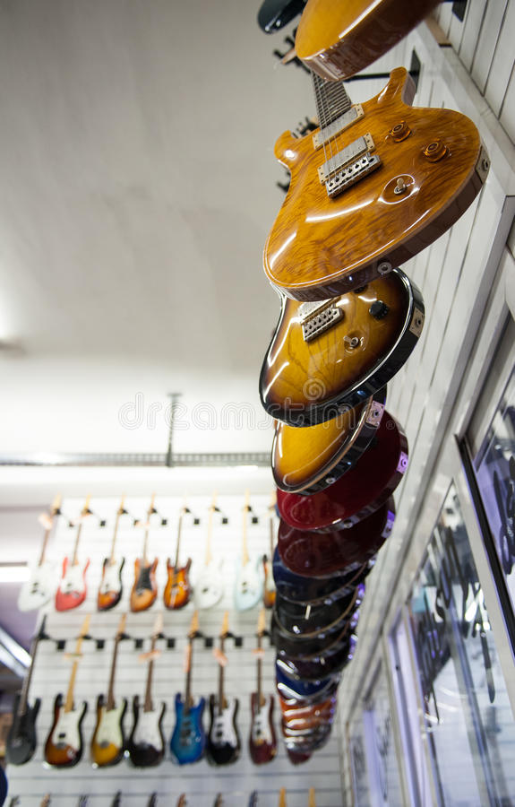 Rome, Italy. September 20th 2016. Electric guitars hanging in s royalty free stock image