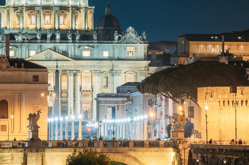 Rome, Italy. St. Peter`s Square With Papal Basilica Of St. Peter In The Vatican And Aelian Bridge In Evening Night. Illuminations stock image