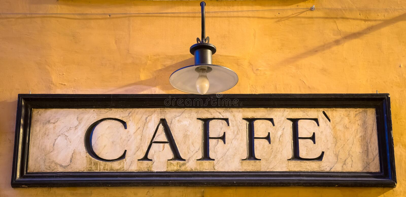 Tradiotional vintage style coffee sign on the wall. Rome, Italy. Tradiotional vintage style coffee sign on the wall stock photography