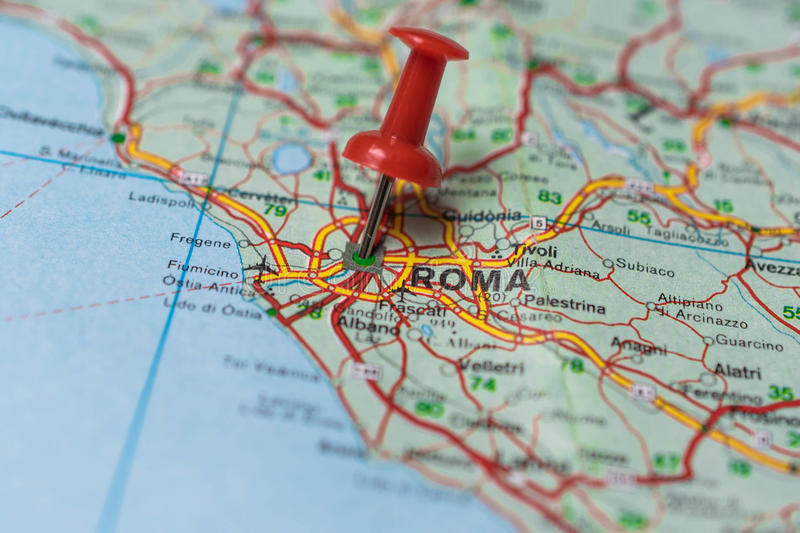 Rome on map. Macro shot of Rome map with push pin shows Rome royalty free stock photos