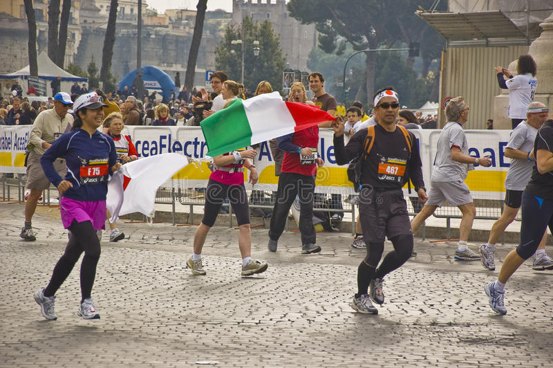 Rome marathon. Runners with flag at rome marathon 2010 stock images