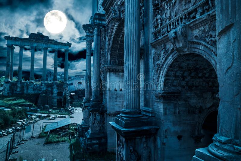 Rome at night, Italy. Fantasy view of old Roman Forum, landmark of Rome. Mysterious ancient ruins of gloomy Rome in full moon royalty free stock photos