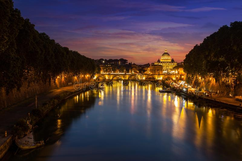 Rome at night. St. Peter. Long Exposure of St. Peters Cathedral in Rome, Italy during beautiful sunset. View of the Vatican with bridges over the River Tiber in