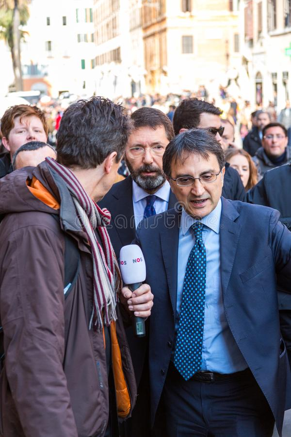 Rome`s Mayor on a Walkabout. Rome, Italy - February 20, 2015: The Mayor of Rome, Ignazio Marino, visited the Barcaccia Fountain at the foot of the Spanish Steps royalty free stock photos