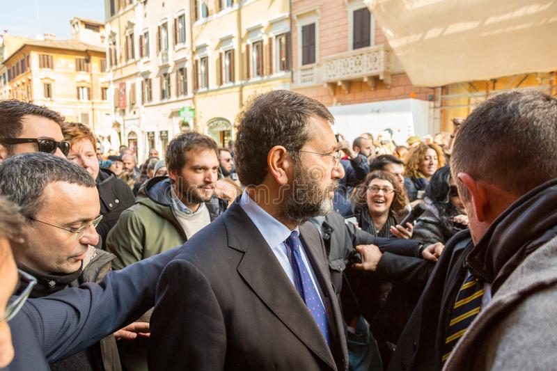 Rome`s Mayor on a Walkabout. Rome, Italy - February 20, 2015: The Mayor of Rome, Ignazio Marino, visited the Barcaccia Fountain at the foot of the Spanish Steps stock photography