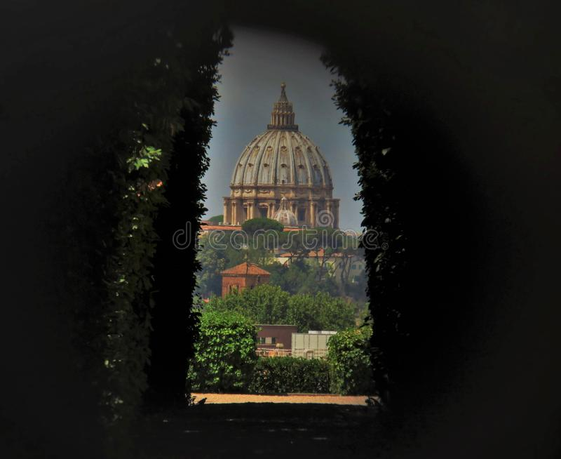 Rome Secret Keyhole Cavalieri di Malta. Looking through the secret key hole at St peters basilica located on Aventine hill in Cavalieri di malta royalty free stock photo