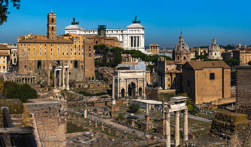 Rome travel destination - beautiful photo of Roman Forum and Victor Emmanuel II National Monument at the background. Beautiful photo of Roman Forum and Victor royalty free stock photography