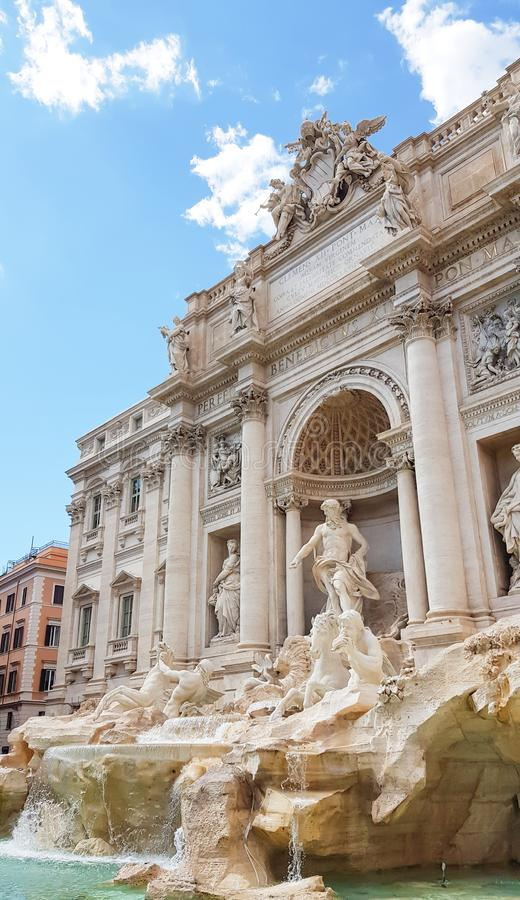 Rome trevi fountain and art statue Fontana di Trevi in Rome, Italy with bright day blue sky. Trevi is most famous fountain of. Rome. Architecture and landmark stock photos