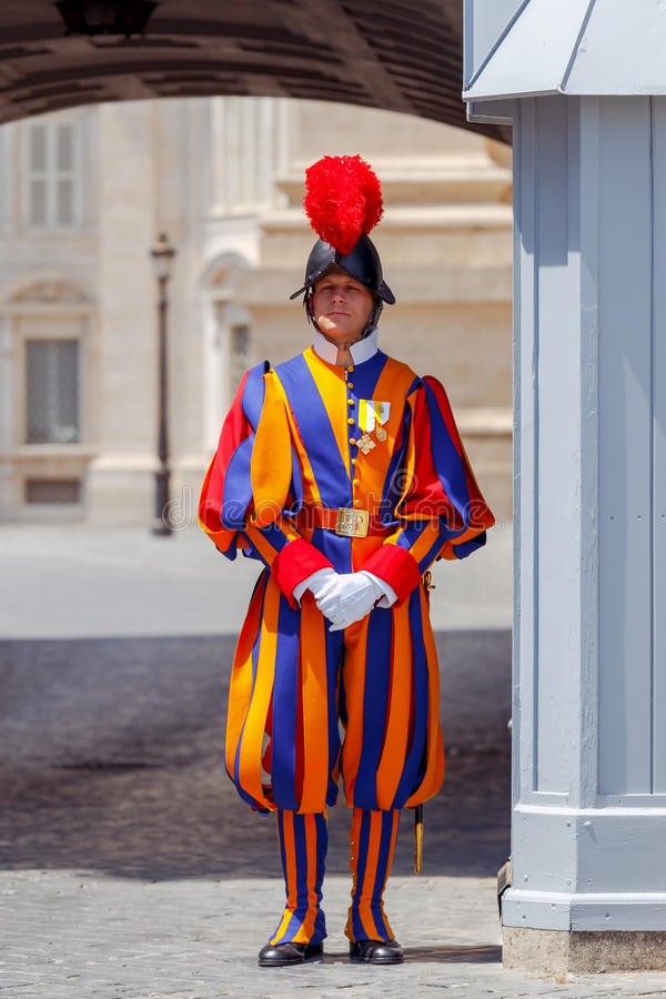 Rome. Vatican guardsman. Rome, Italy - May 18, 2017: The Swiss guardsman in parade uniform on the post in front of the Vatican palace in Rome. The Vatican is royalty free stock photo