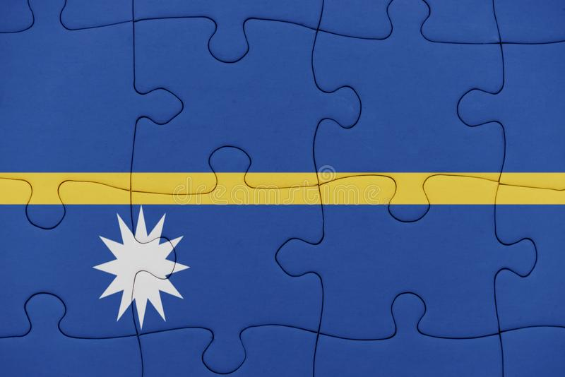 Rompecabezas con la bandera nacional de Nauru imagenes de archivo