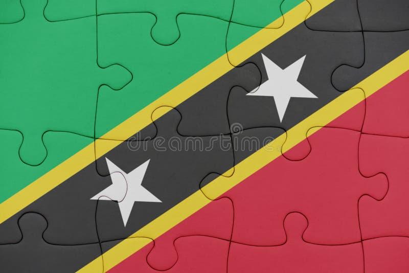 Rompecabezas con la bandera nacional del santo San Cristobal y Nevis imagen de archivo