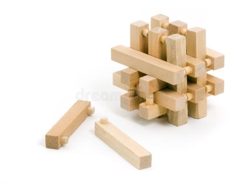 Rompecabezas de madera con dos pedazos tirados fotografía de archivo libre de regalías