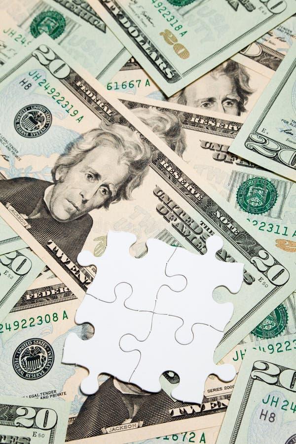 Rompecabezas del dólar imágenes de archivo libres de regalías