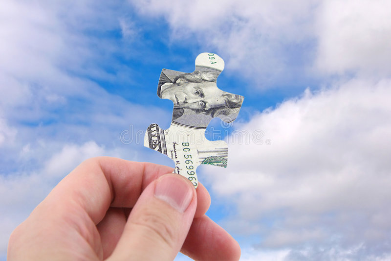 Rompecabezas del dólar del asimiento de la mano imagen de archivo libre de regalías