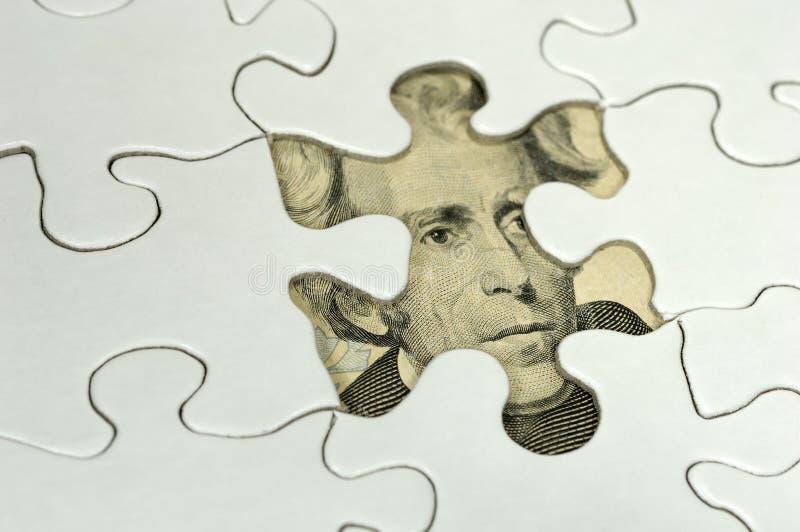 Rompecabezas financiero foto de archivo