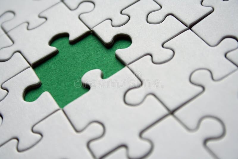 Rompecabezas verdes foto de archivo libre de regalías