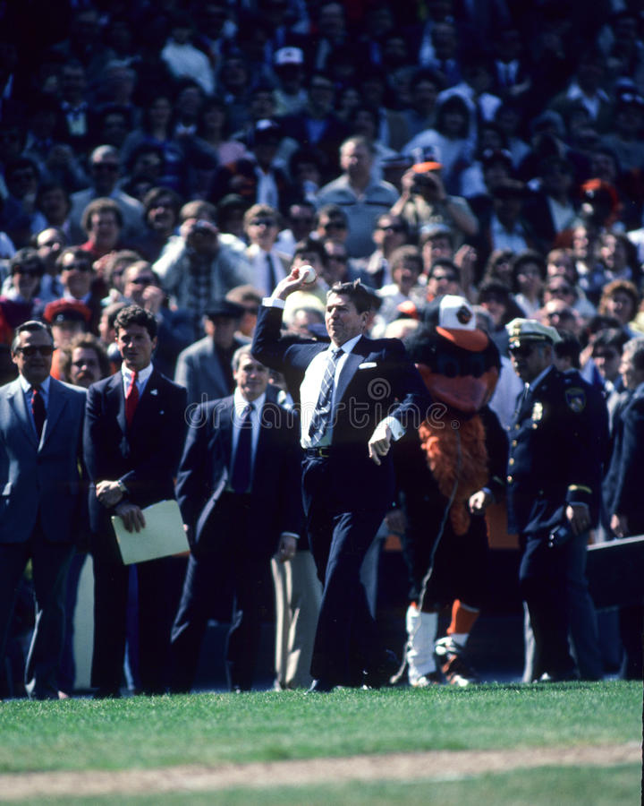 Ronald Reagan. President Ronald Reagan throws out the first pitch of a Baltimore Orioles game. (Image taken color slide stock photos