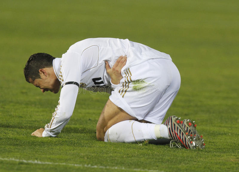 Ronaldo. Portuguese soccer player Cristiano Ronaldo gestures on floor after colliding with another player during a match in Mallorca, Spain stock photo