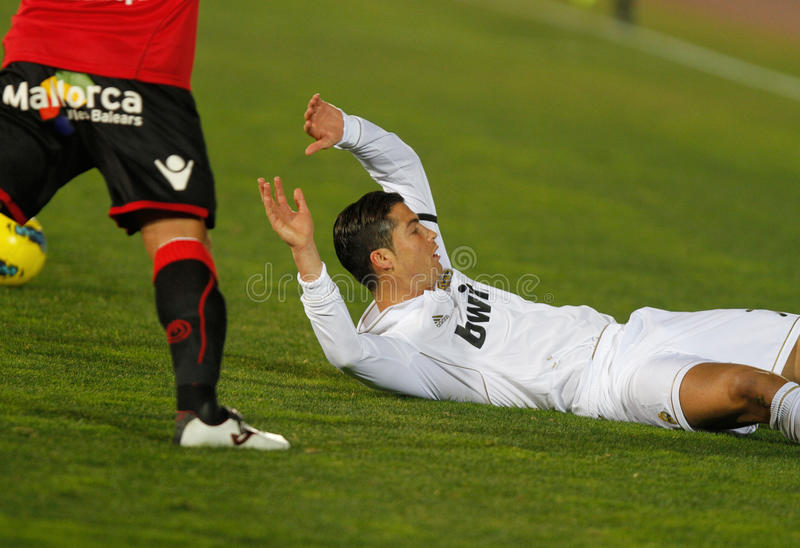 Ronaldo. Portuguese soccer player Cristiano Ronaldo gestures on floor after colliding during a match in Mallorca, Spain stock image