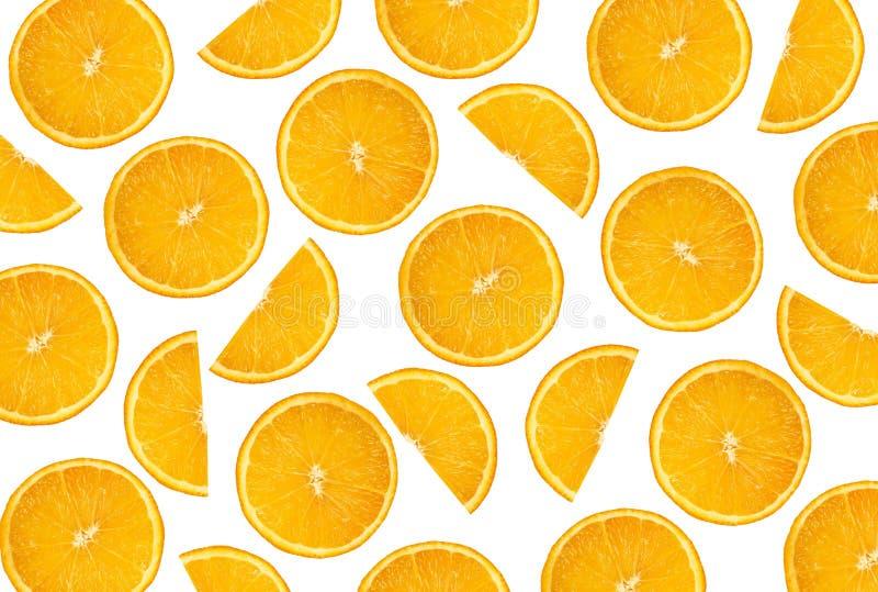 Ronda cortada y naranja partida en dos en un fondo limpio blanco fotografía de archivo libre de regalías