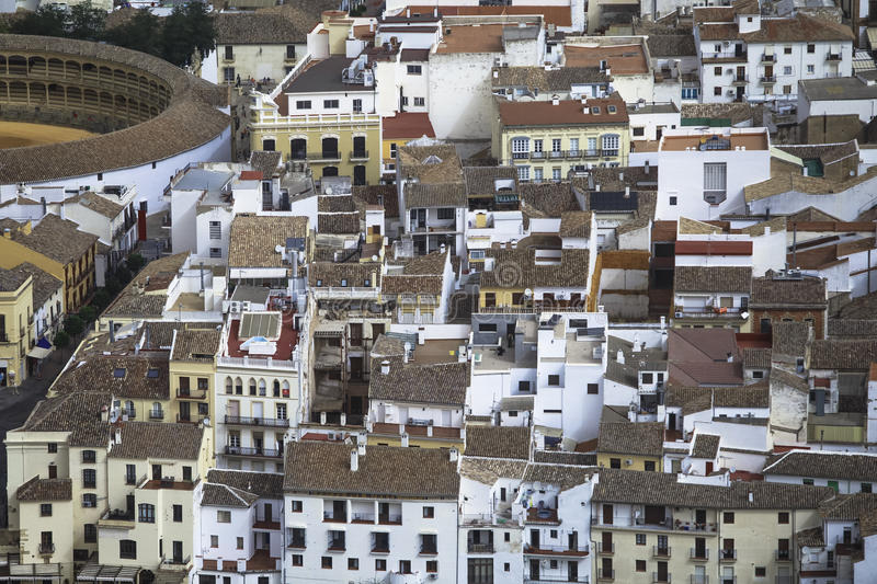 Ronda, Málaga, Spain. Bullring and houses. The Plaza de toros de Ronda [1] The arena has a diameter of 66 metres (217 ft), surrounded by a passage formed by stock photo