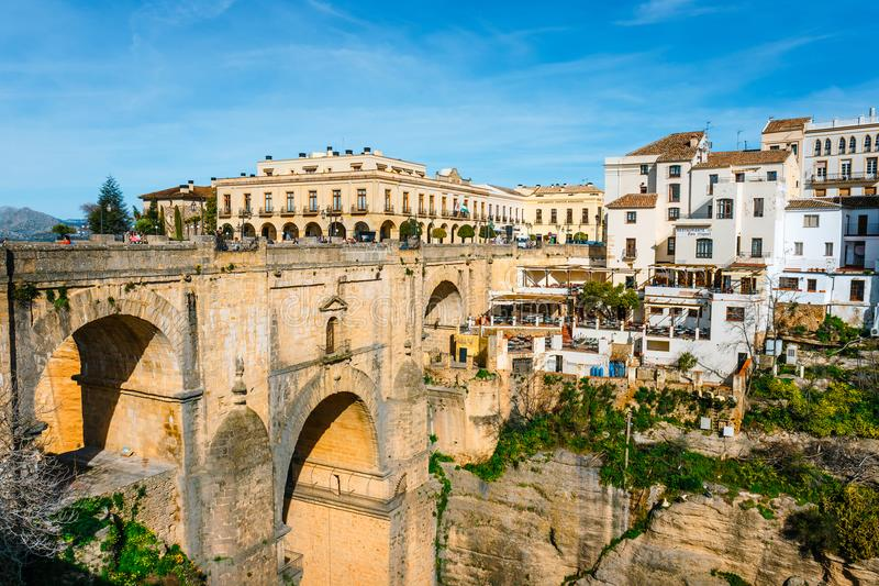 El Tajo Gorge Canyon with new bridge and white spanish houses in Ronda, Andalusia, Spain. Ronda, Spain, April 05, 2018: El Tajo Gorge Canyon with new bridge and royalty free stock photos