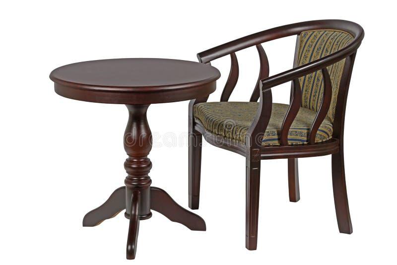 Rondetafel en stoel op witte achtergrond wordt geïsoleerd die royalty-vrije stock afbeeldingen