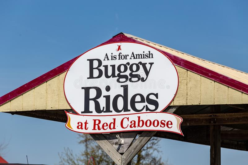 Buggy Rides at Red Caboose Motel Sign. Ronks, PA, USA - April 23, 2018: The Red Caboose Motel, where guests can stay in vintage cabooses from former railroads stock photography