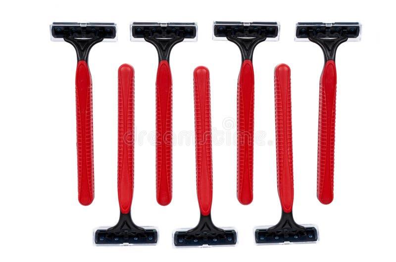 Rood beschikbaar die het scheren scheermes op witte achtergrond wordt geïsoleerd royalty-vrije stock afbeelding