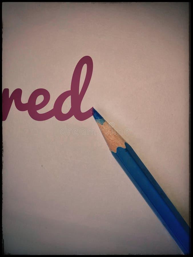 Rood in blauw stock afbeelding