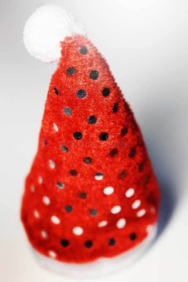 Rood de hoedenstuk speelgoed van Santa Claus voor Kerstmis of nieuw jaar stock afbeelding