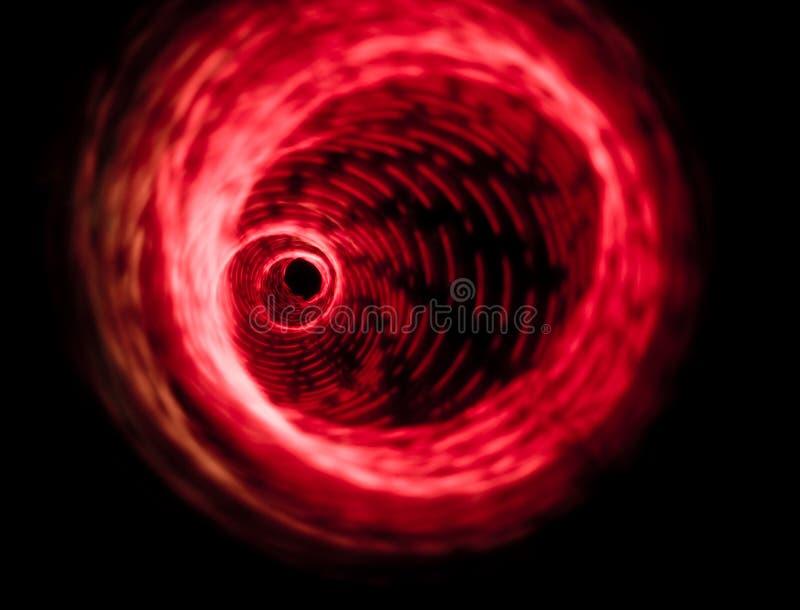 Rood draaikolk het spinnen ontwerp royalty-vrije stock foto's