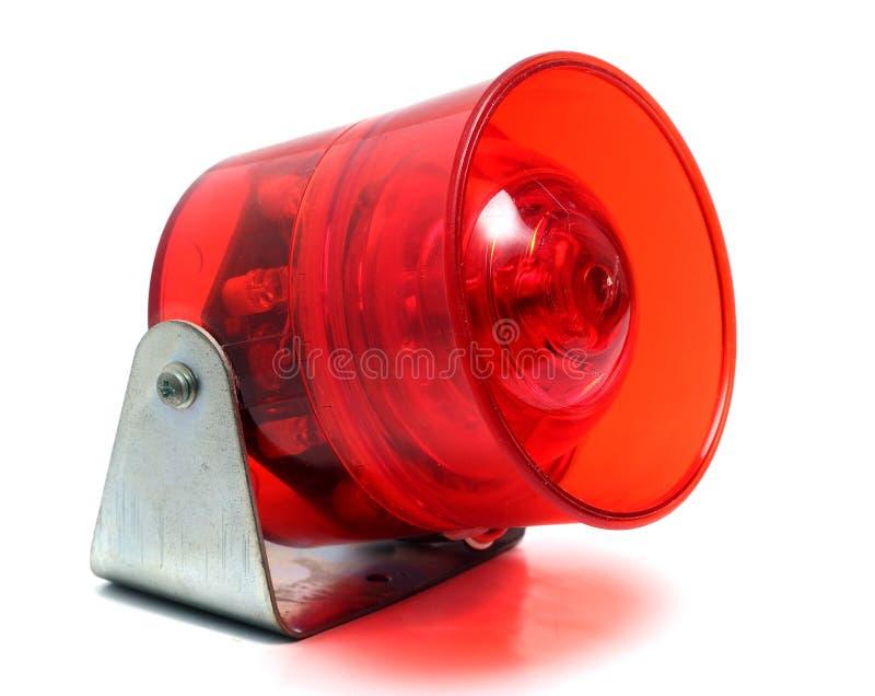 Rood een sirene op wit wordt geïsoleerd dat stock foto