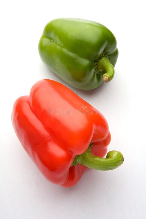 Rood en groene paprika's stock foto's