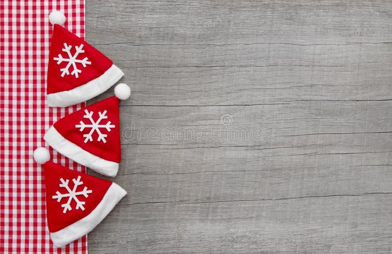 Rood gecontroleerd kader met oud hout voor een Kerstmisachtergrond en r stock afbeelding