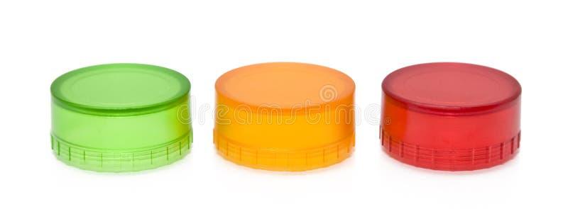 Rood geelgroen plastic deksel royalty-vrije stock afbeeldingen