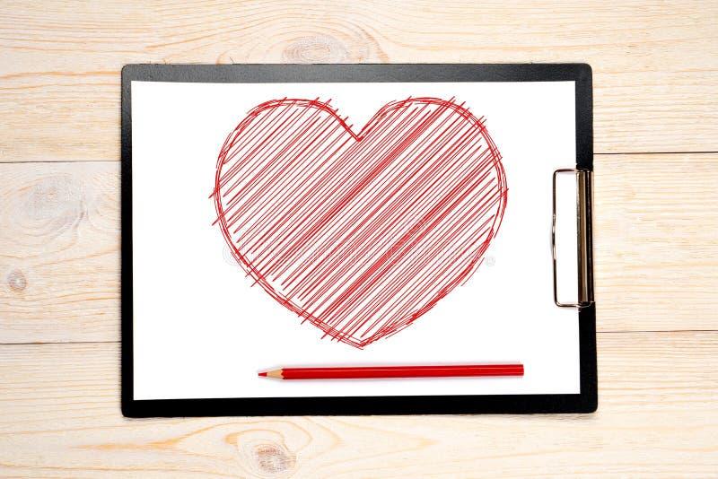 Rood geschetst die hart op papier wordt getrokken stock foto's