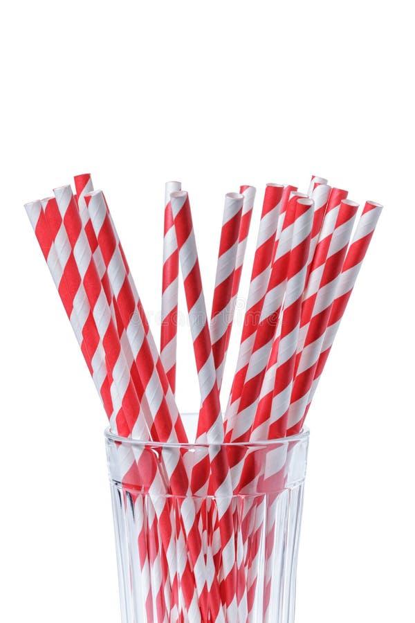 Rood gestreept document stro in glas royalty-vrije stock afbeelding