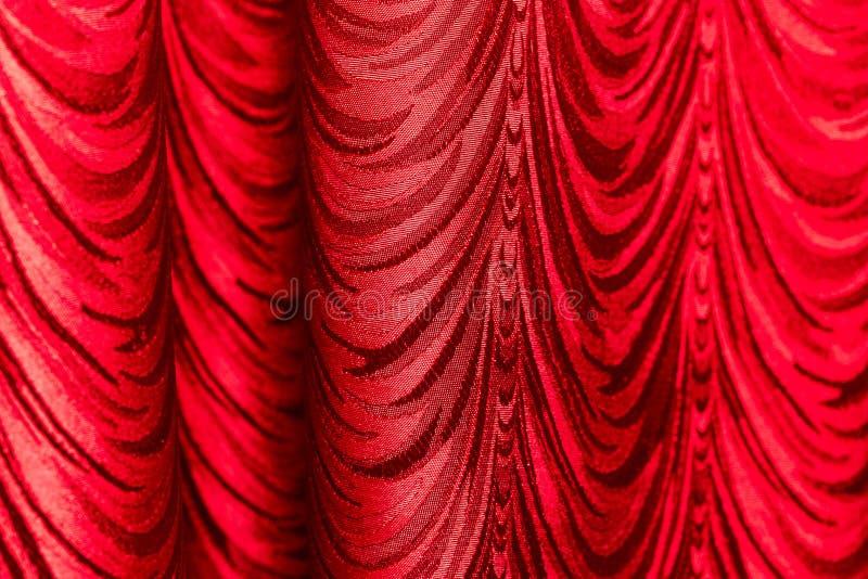 Rood gordijn als abstracte achtergrond stock afbeeldingen