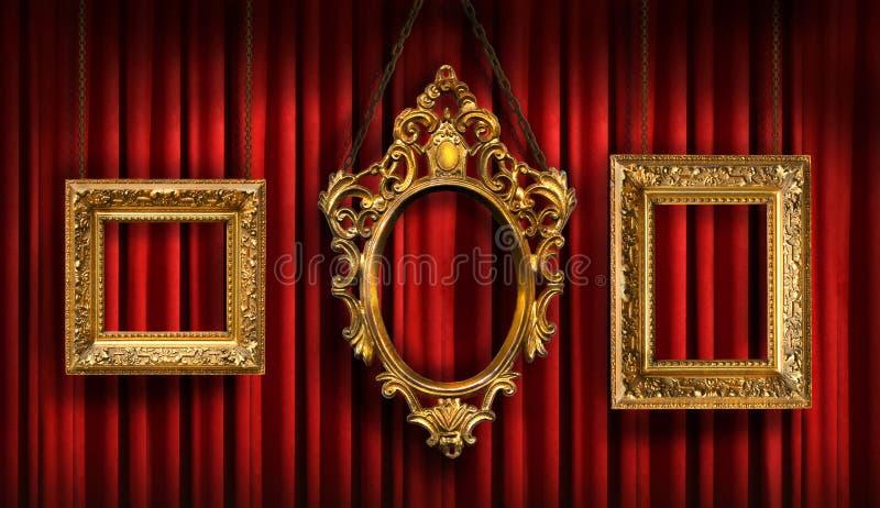 Rood gordijn met drie frames royalty-vrije stock afbeelding